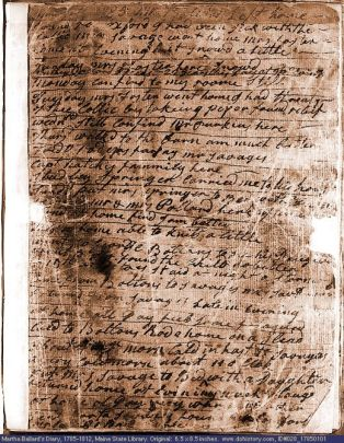 a page of tightly packed cursive. the paper is creased, there are black ink spots and faded spots.