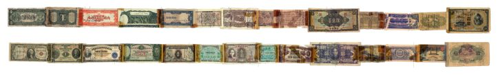 A series of currencies, mostly from Pacific nations, taped together in a line.
