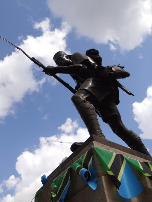 Photo of a Tanzanian soldier holding a bayonet, from below.