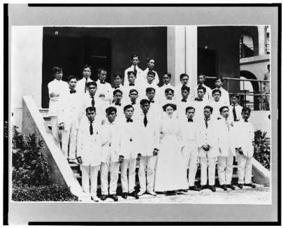 A group of Filipino nurses standing on steps