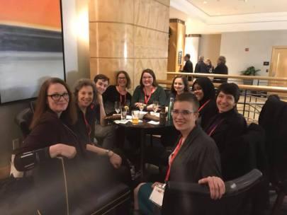 Nursing Clio team members at the AHA. Left to right: Jacki Antonovich, Lizzie Reis, RE Fulton, Cassia Roth, Laura Ansley, Cassandra Berman, Ayah Nuriddin, Lara Freidenfelds, and Molly Brookfield.