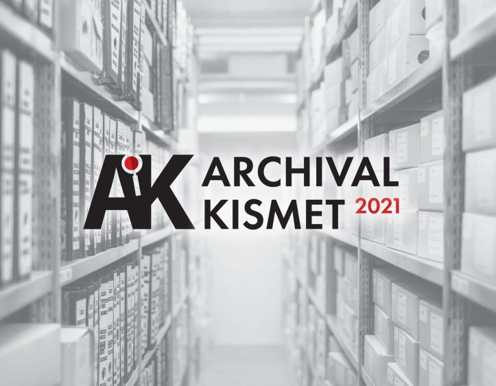 """The letters """"AK"""" and phrase """"Archival Kismet 2021"""" are centered over a black and white image of shelves lined with archival boxes."""