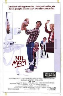 Michael Keaton holds a bear in the air while two children surround him and wrap his legs with a bedsheet, and a white woman, his wife, waves goodbye, briefcase in hand