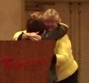 Lucy Bradley-Springer congratulating Leslie Nicoll on receiving the award