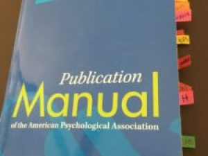 APA Manual with Tape Flags