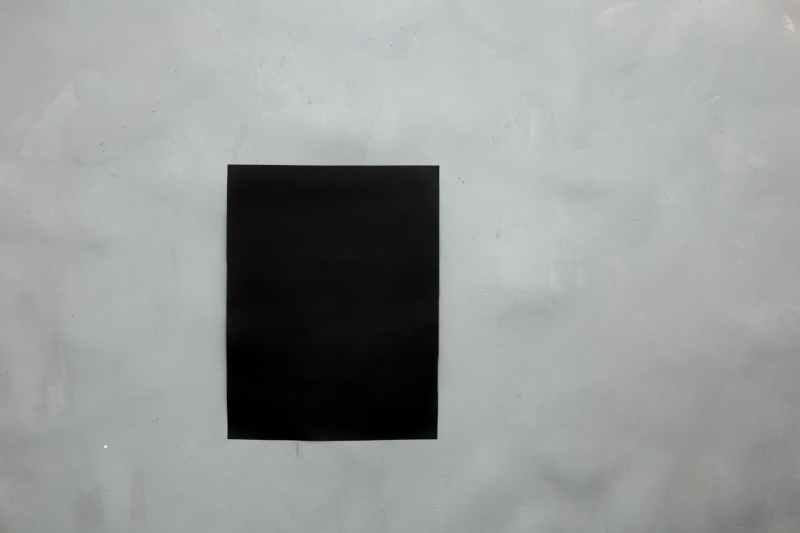 black blank paper on wall