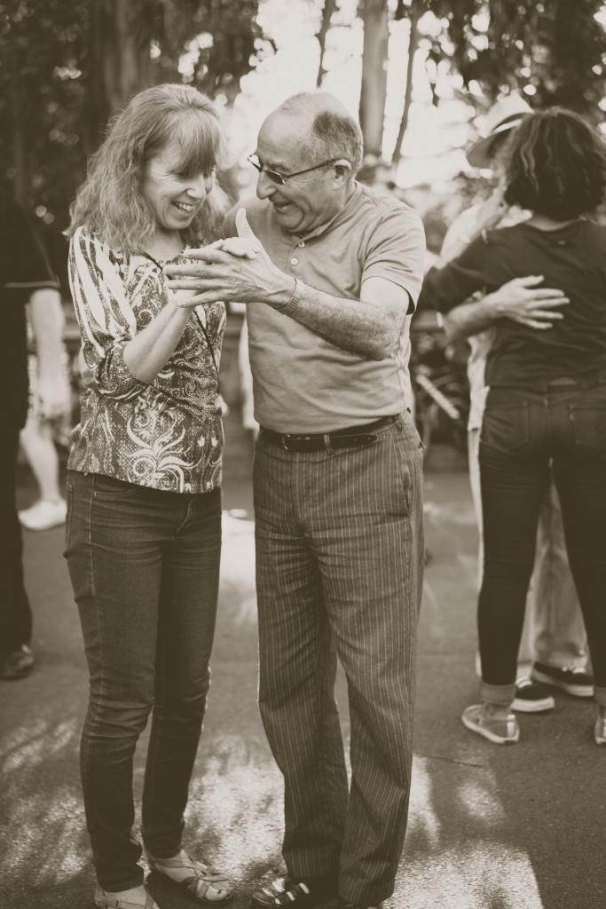 Couple dancing.  This represents family members having a good time at a summer social.
