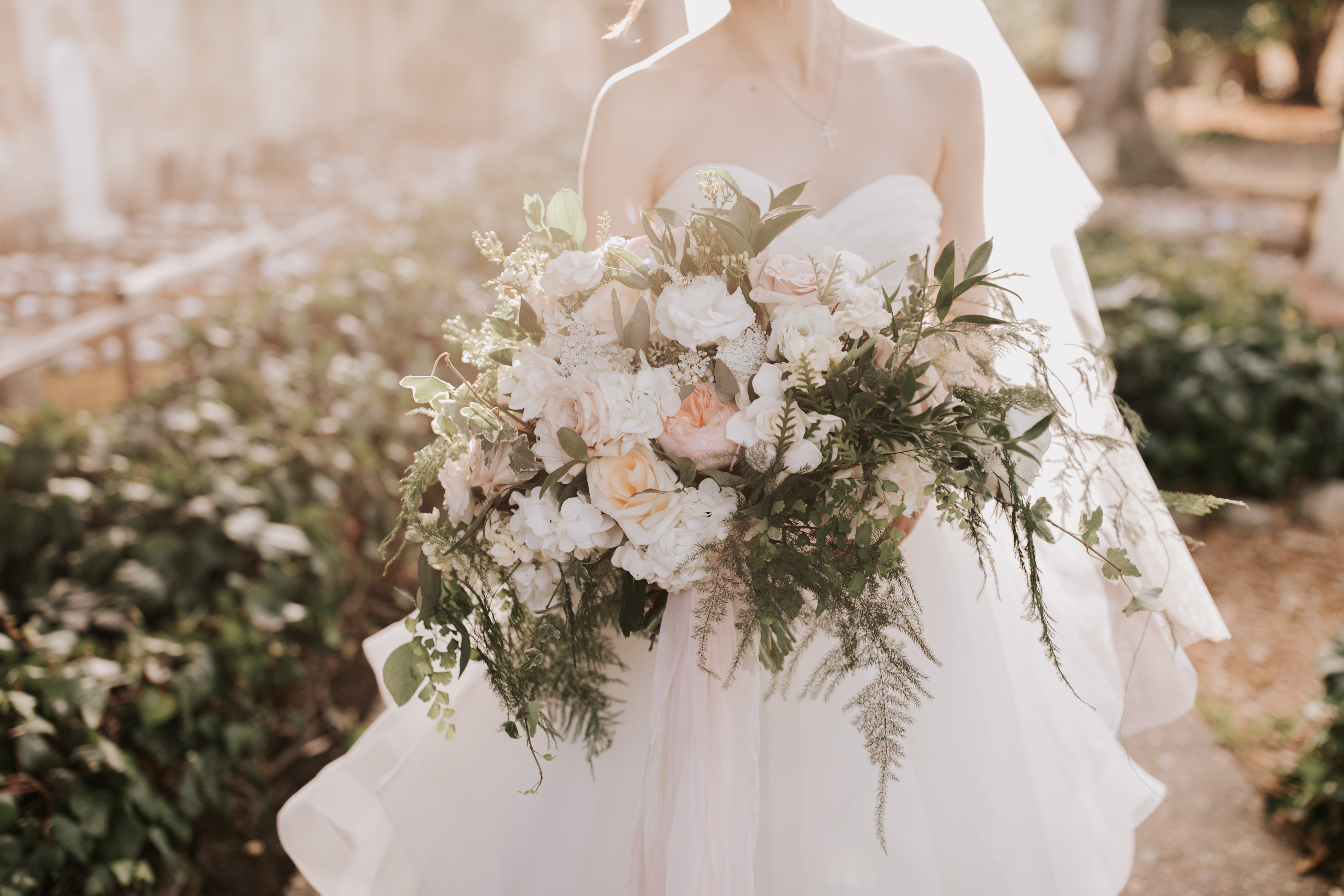 A lush cream wedding with lots of greenery