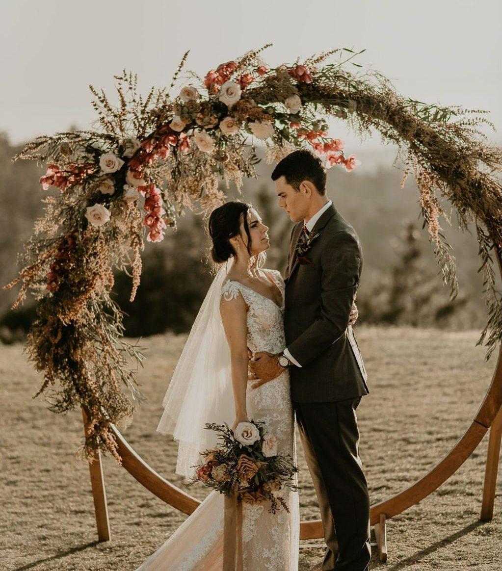 Boho RusticBoho Rustic wedding inspiration with texture, dried, neutral tones with lush foliage and maroon orchids. Wedding