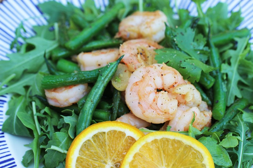 orange garlic sustainable shrimp with arugula
