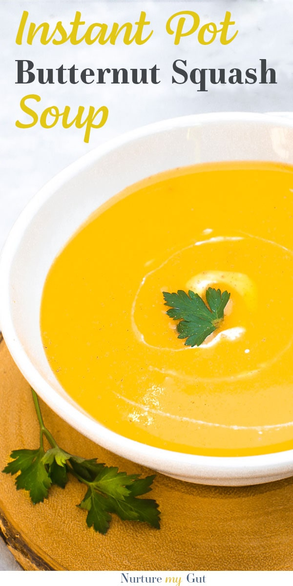 Instant Pot Butternut Squash soup in white bowl with parsley and nutmeg garnish