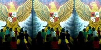 Lukisan Yakub Kelana (Nampak muda-mudi Indonesia menuju lambang Garuda Pancasila). Ilustrasi: NusantaraNews.co