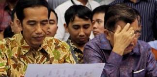 Pasangan Presiden dan Wakil Presiden Jokowi-JK tampak duduk bersandingan/Foto via okezone