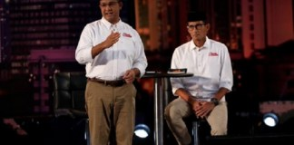 Anies-Sandi saat #Debat1PilkadaDKI /Foto : Istiemwa