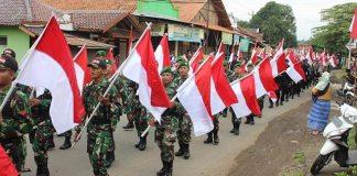 kirap merah putih bertajuk Indonesiaku Indonesiamu Indonesia Kita Bhineka Tunggal Ika di kecamatan Warungasem, Kabupaten Batang. Foto Dok. Kodim 0736