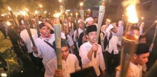 Pawai Obor Oleh Warga Sukamaju, Kecamatan Cilodong, Kota Depok. Foto Andika/Nusantaranews