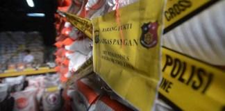 ILUSTRASI: Penggerebekan gudang beras. (Foto: Merdeka)