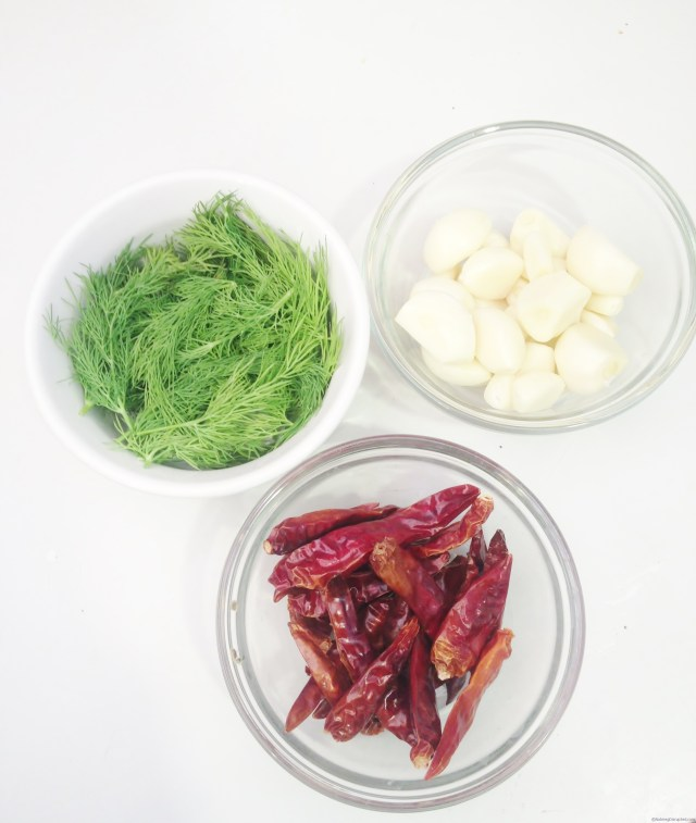 Dill, garlic and red chili peppers for pickling in the Nutmeg Disrupted kitchen