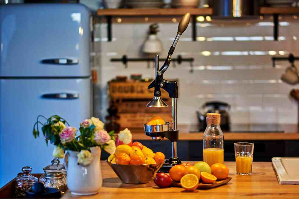 Orange juice freshly squeezed from fresh fruits with a manual juicer