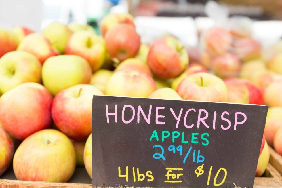Fresh Organically grown honeycrisp apples with price sign at the farmers' market