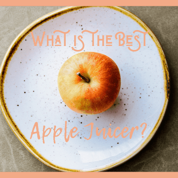 Apple in middle of white plate on a wooden table with words What is the Best Apple Juicer above and below the image