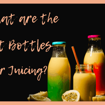 Juicing bottles filled with bright colored juices with slices of passion fruit and citrus wedges next to the bottles