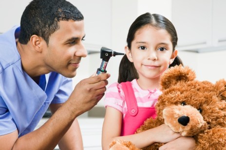 Doctor using otoscope