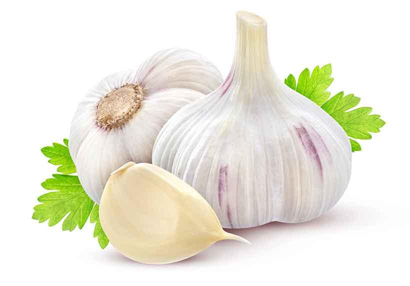 Whole Garlic With Skin and a Garlic Clove.
