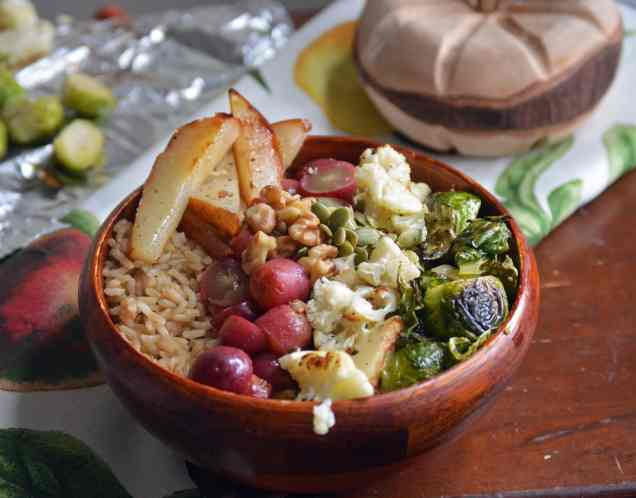 brown rice bowl with brussels sprouts, cauliflower, roasted grapes and roasted pears