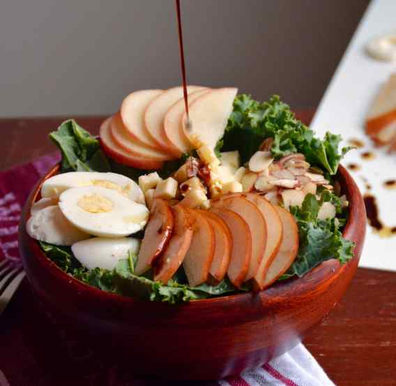 kale salad with apples, pears, cheddar cheese, toasted almonds