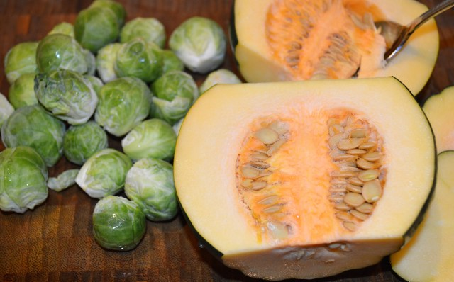 Raw Acorn Squash and Trimmed Brussels Sprouts