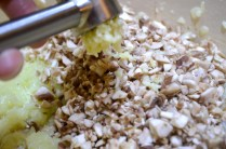 Adding mushrooms and garlic to sautéd onions for Italian Mushroom and Pea Risotto