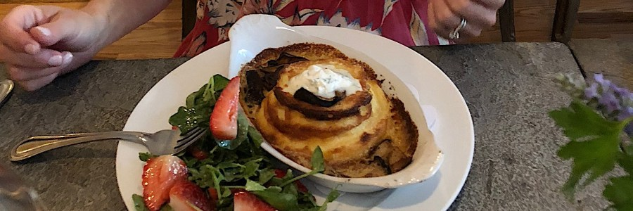 My dinner at Seattle's Boat Street: Goat's Cheese Souffle with a beautiful arugula strawberry and mint salad