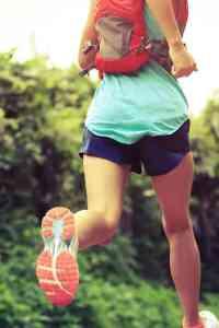 female vegan ultra runner running on trail