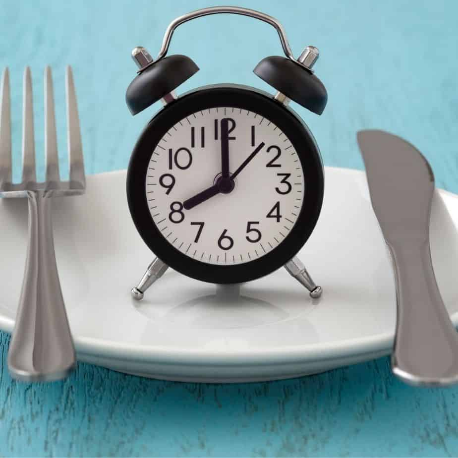 clock on plate with utensils signaling when to eat