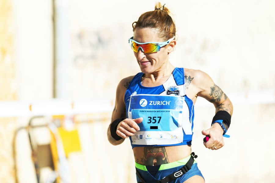 Woman with sunglasses running ultramarathon