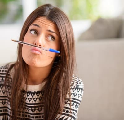 Girl with pen, thinking