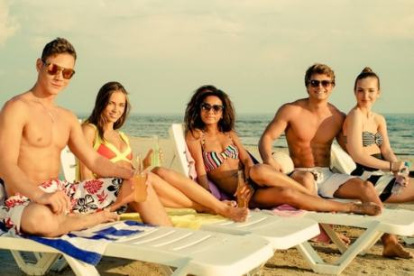 Group sunbathing, multiple ethnicities