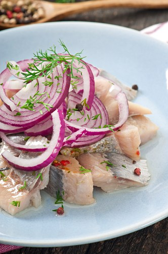 Red onions on cooked fish