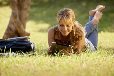 Woman with tablet in the sun