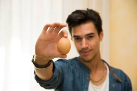 Young man with egg