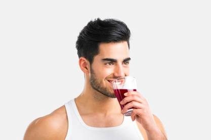 Athletic man drinking a juice, detox concept