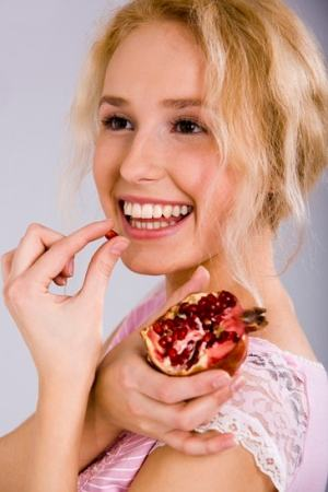 Girl eating pomegranate