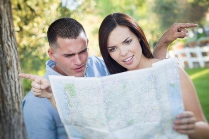 Man and woman looking at a map