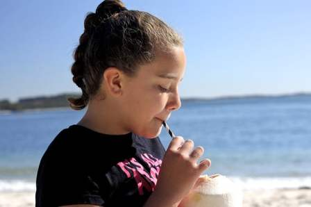 Girl drinking coconut water
