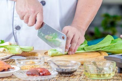Cook cutting kale