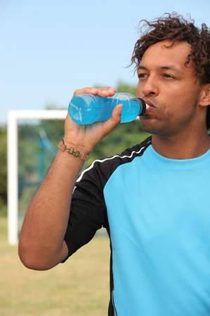 Man drinking a sports drink