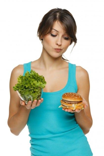 Choosing between a burger and vegetables