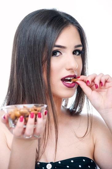 Girl eating almonds