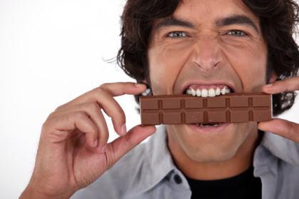 Man playfully eating chocolate